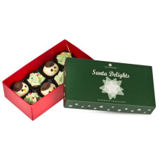 delicious pralines in a shape of a Christmas tree with a hazelnut filling, snowman pralines