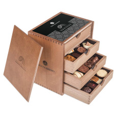 hand made pralines in wooden boxes